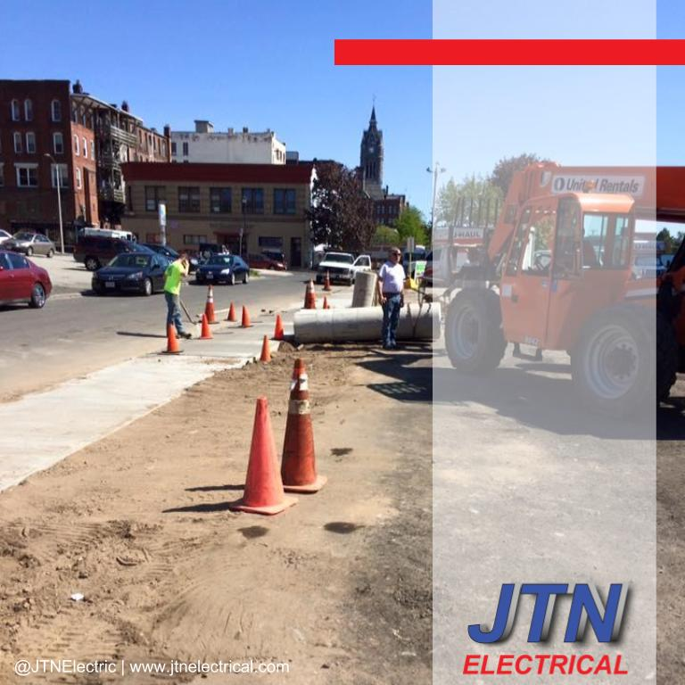 Running conduits and installing bases of outdoor parking lot lighting poles in Holyoke Massachusetts by JTNelectric